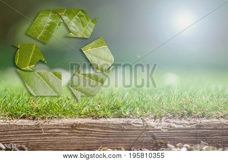 Recycling Background With Recycle Symbol Over Grass