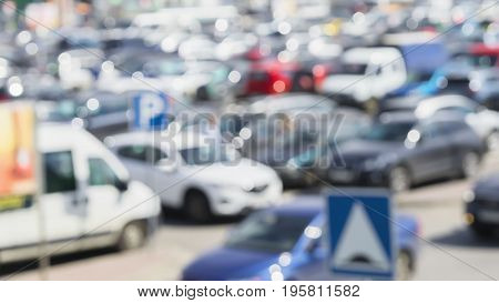 Blurred outdoor parking cars in the city at peak hour.