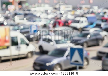 Abstract blurred outdoor car parking area, parking lot, sales retail, season sales, modern shopping mall at peak hour