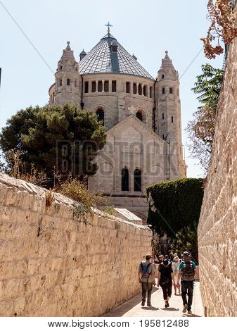 Jerusalem Israel July 14 2016 : Tourists walk along the passage along the narrow street Ma'ale HaShalom to the Dormition abbey in old tow in Jerusalem