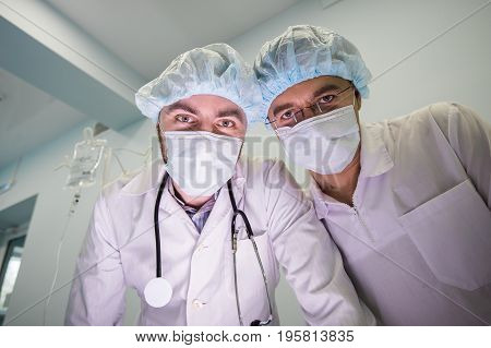Experienced doctors during the operation at hospital. First point of view