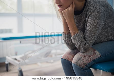 Woman's hand waiting for doctor in hospital feeling worried