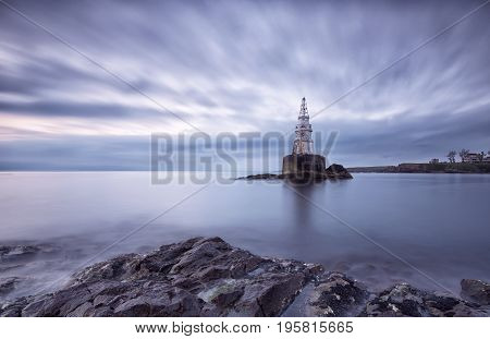 Sunrise Of The Lighthouse In Ahtopol, Bulgaria. Blue Hour Seascape. Long Exposure