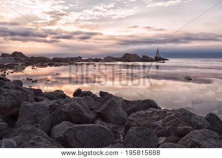 Sunrise Of The Lighthouse In Ahtopol, Bulgaria. Sea And Rocks