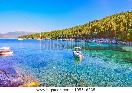 Calm and idyllic Beach of Foki Fiskardo with crystal clear and transparent water, Kefalonia, Ionian islands, Greece.