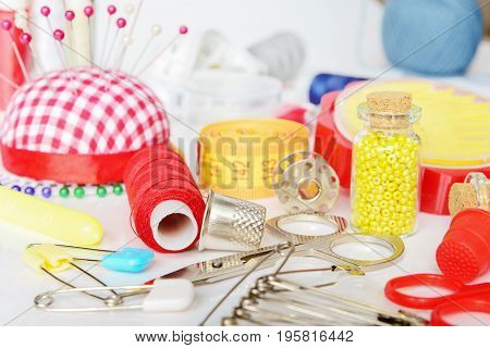 Sewing kit: threads needles pins scissors beads centimeter tape etc.
