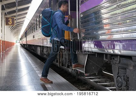 Young Man, Tourist Or Traveler Stepping Up To The Train On Railway At Train Station. Travel, Journey