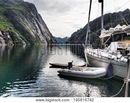 OLYMPUS DIGITAL CAMERA. View of the fjord of the Troll in Norway. Sailing yacht. Norwegian fjord. Natural landscape. Location: Polar circle, Scandinavia. White nights morning. A summer travel by the boat.