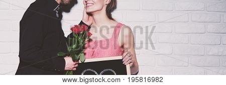 Man Giving Rose To Girlfriend