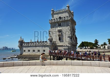 Lisbon Portugal - June 11 2017: Belem Tower or Torre de Belem on the bank of Tagus River at sunset. UNESCO World Heritage Site. Monument of Portuguese maritime discoveries of the era of Age of Discoveries