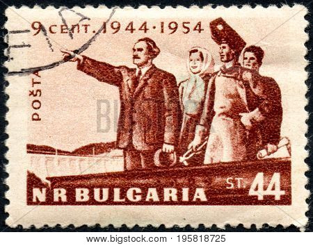 UKRAINE - CIRCA 2017: A postage stamp printed in Bulgaria shows G. Dimitrov with working People from series 10th Anniversary of the Liberation circa 1954