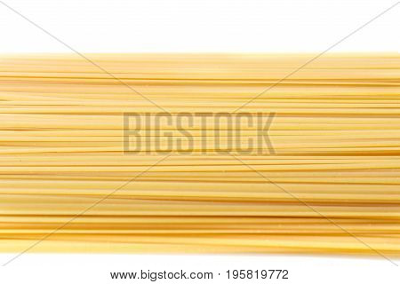 Top view of raw and rigate noodle pasta, isolated on a white background. Flour products. Raw homemade pasta. Makaroni meal for dinner. Italian spaghetti pasta dried food.