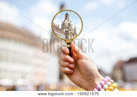 Watching through a magnifying glass on the famous church of Our Lady in Dresden city, Germany