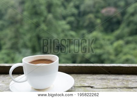 Hot Coffee In White Cup On Wood Table With Green Nature Background