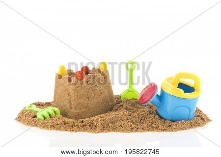 Plastic toys for building a sand castle at the beach for the family vacation