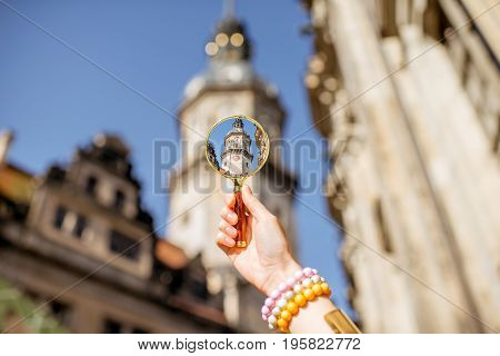 Watching though a magnifying glass on the Hausmannsturm tower of the old castle in Dresden, Germany