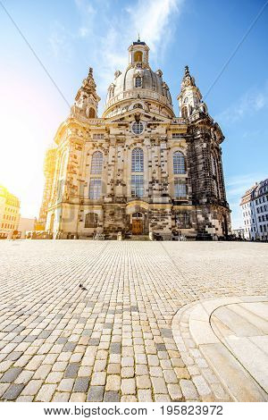 View on the main city square with famous church of Our Lady during the sunrise in Dresden city, Germany