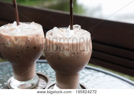 Iced Chocolate Cocoa Drink In The Glass On Table At Cafe