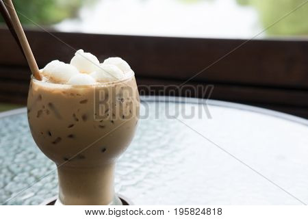 Iced Coffee Or Mocha Drink In The Glass On Table At Cafe