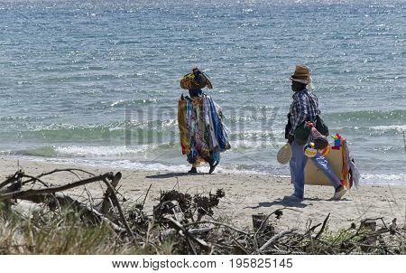 Follonica Italy - September 09 2015: African sellers on the Italian beach
