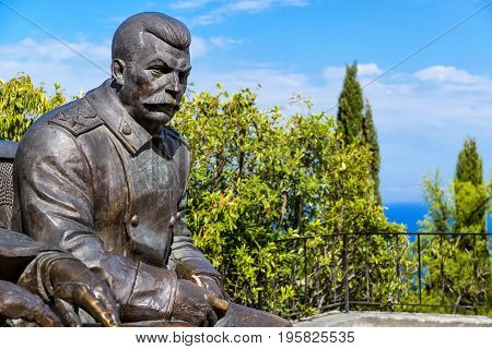 Livadia, Russia - May 17, 2016: Statue of soviet leader Stalin by Zurab Tsereteli in the Livadia Palace, Crimea. The famous Yalta Conference was held there in 1945.