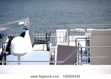 The close-up of a ship radar as well as a radar antenna at the stern of a yacht.