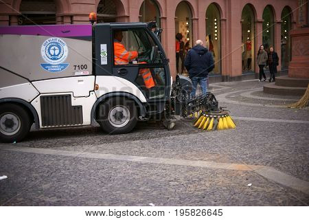 MAINZ, GERMANY - APRIL 20: An environmentally friendly road cleaning vehicle cleans the floor of the market square after the weekly market on April 20 2017 in Mainz.