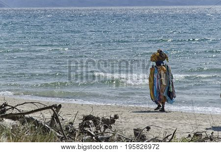 Follonica Italy - September 09 2015: African seller on the Italian beach
