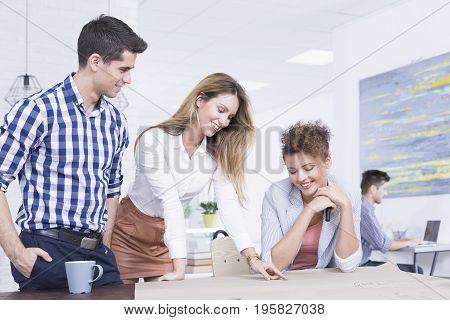 Co-workers Team Brainstorming At Desk