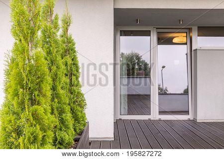 Terrace entrance to house through glass doors