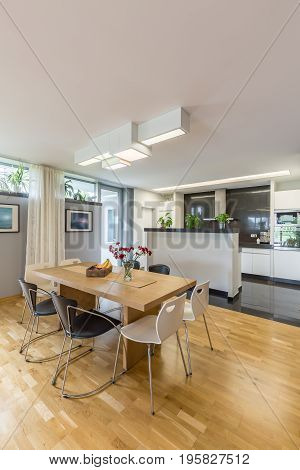 Spacious and modern kitchen with kitchenette and dining table with chairs