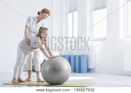 Girl With Bad Posture Exercising