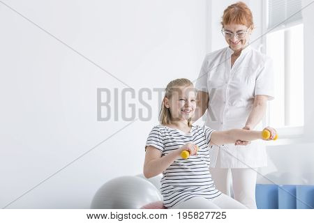 Kid Exercising With Dumbbells