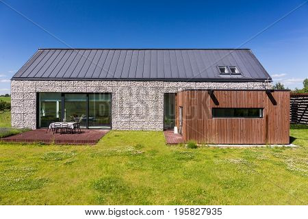 Energy-efficient House Covered With Pebbles