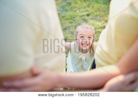 Child with parents in the park. Concept parenting.