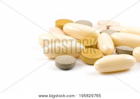 Macrophotography of medications in tablets and capsules on the white background