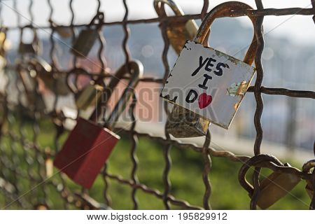 Several padlocks of love vows locked in a gri