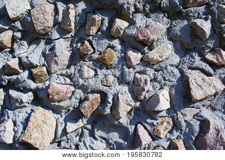 Background texture of a stone wall on a building