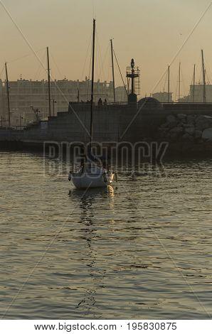 View of sundown over the harbor of Rimini