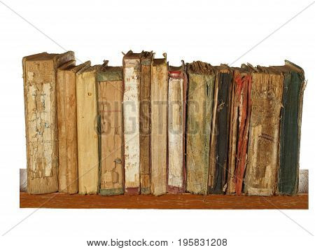 Very old and worn books on a wooden shelf isolated on white background.