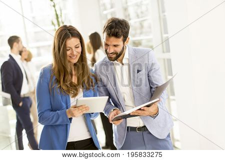 Young bussiness couple with tablet in the office