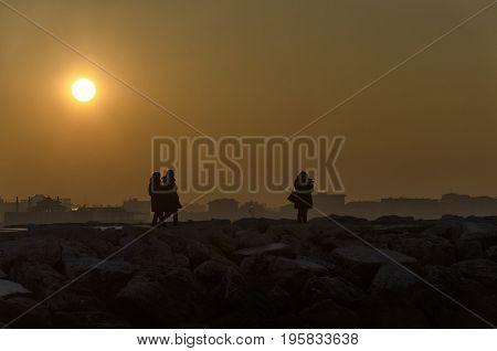 View of people watching an amazing sundown