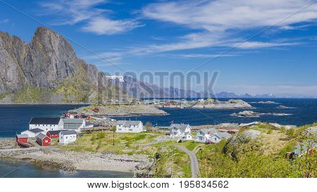 Island of Hamnoy, in northern Norway. The Norwegian fishing village with the typical rorbu houses.  Mountain In Background
