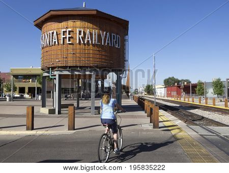 SANTA FE, NEW MEXICO, JULY 6. The Santa Fe Rail Trail on July 6, 2017, in Santa Fe, New Mexico. A Woman Cyclist at the Beginning of the Santa Fe Rail Trail in Santa Fe New Mexico.