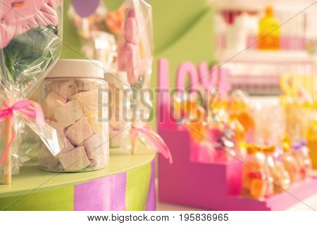 Jar with marshmallow on counter at candy shop