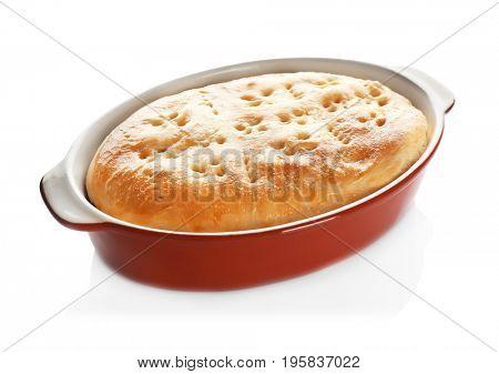 Baking dish with turkey pot pie on white background