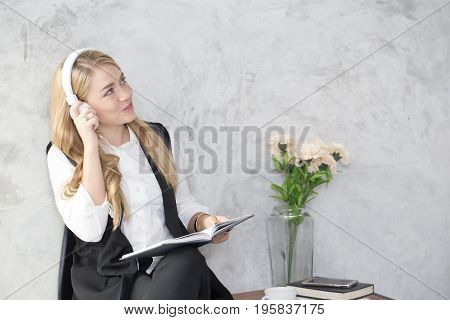 Young Women Listening Music While Thinking Woman Doing Homework In Modern Place Woman Working With H
