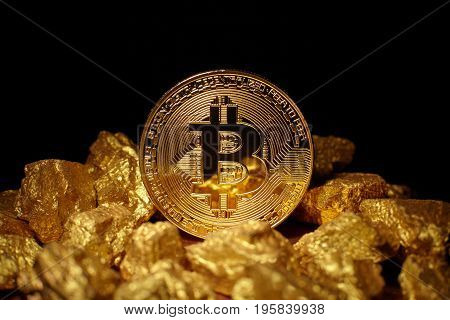 Golden Bitcoin Coin and mound of gold. Bitcoin cryptocurrency. Business concept.