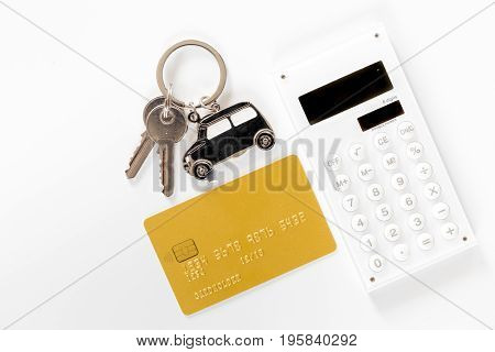 Buying car. Car keys and bank card on white background top view.