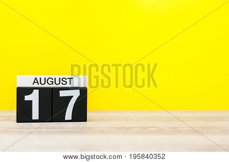 August 17th. Image of august 17, calendar on yellow background with empty space for text. Summer time.